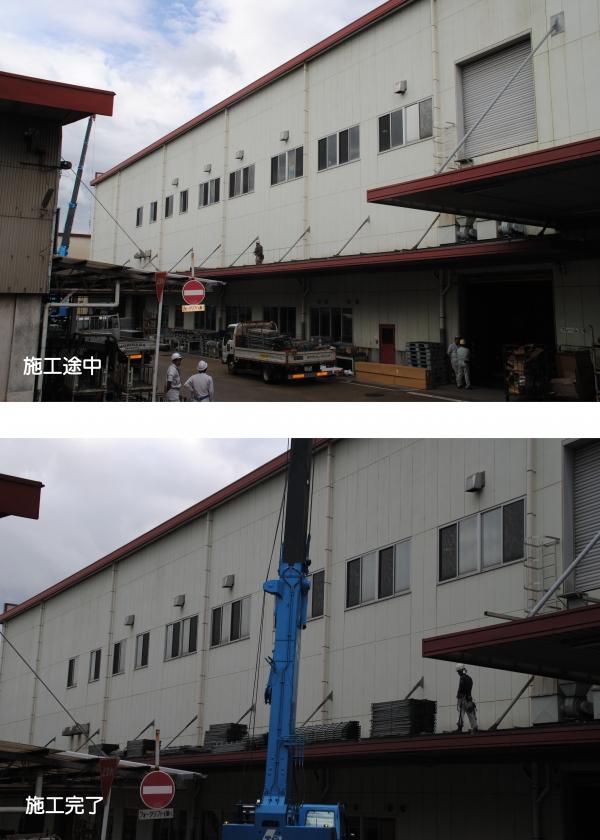 工場の窓ガラスへの省エネフィルムの施工現場